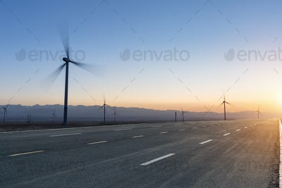 gobi road at dusk and wind farm on chaka salt lake, China