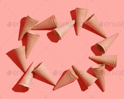 Waffle sweet cones pattern on a color background of the year 2019 Living Coral Pantone. Place for