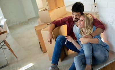 Couple enjoying their new luxurious home