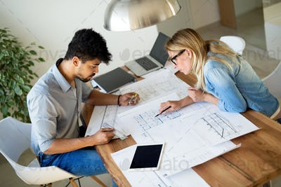 Business People and architects working on project together