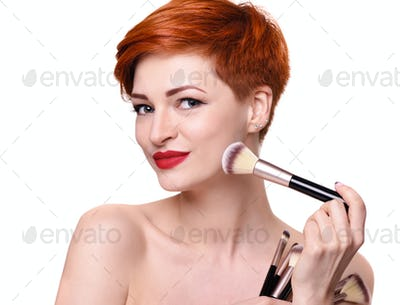Portrait of a beautiful young woman with short red hair with mak