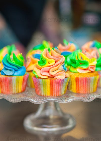Colorful cupcakes with rainbow cream.