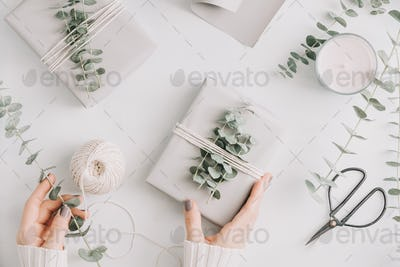 Girl's hands hold a gift box