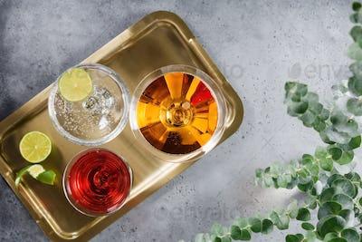 Three alcoholic cocktails