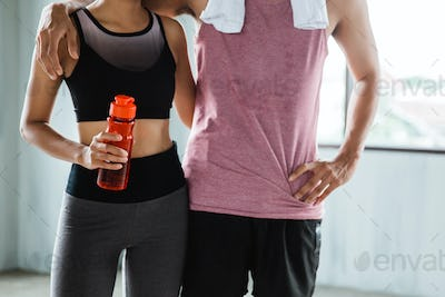 close up of two sport couple at the gym