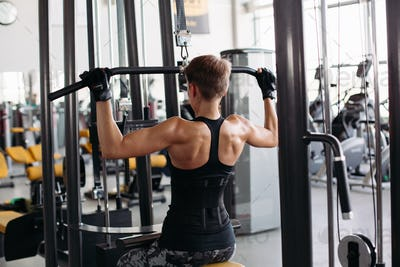 Sporty woman doing thrust of upper block to chest by hands