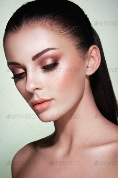 Beautiful woman face with perfect makeup