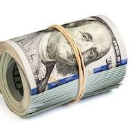 Roll of hundred dollar bills isolated
