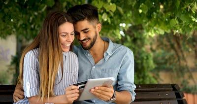Happy couple doing shopping on internet