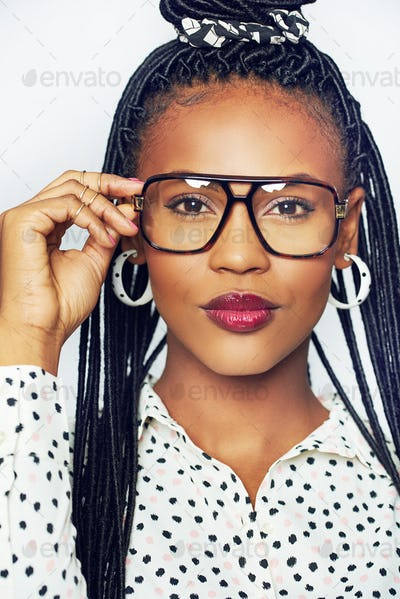 African-American woman in glasses looking at camera