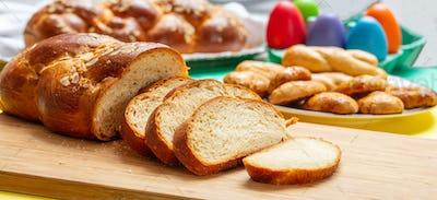 Easter tsoureki braid slices, greek easter sweet bread, on wood