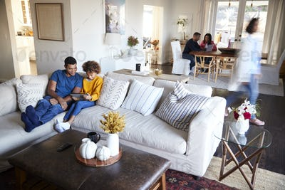 Three generation family family spending time in their open plan living room