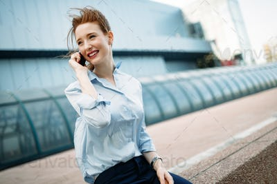 Business woman speaking cellphone