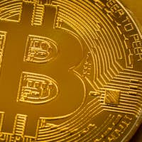 Top view closeup photo of one gold bitcoin