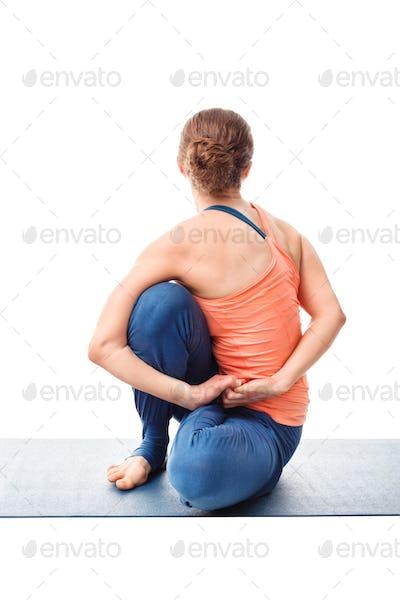 Woman doing Ashtanga Vinyasa Yoga asana Marichyasana D