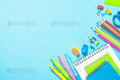 School and office supplies on blue background