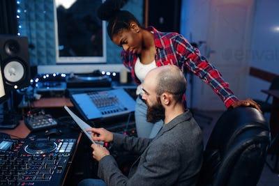 Bearded sound engineer in audio recording studio