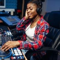 Female sound operator in audio recording studio