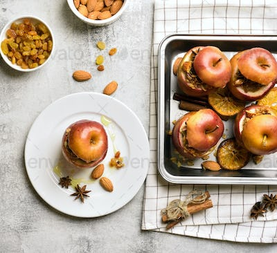 Baked apples with granola, cinnamon, nuts and hone