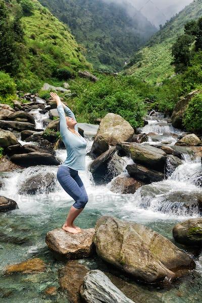 Sorty fit woman doing yoga asana Utkatasana