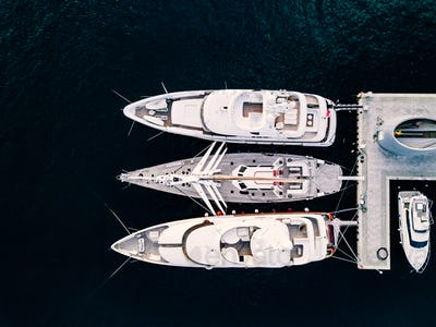 Aerial view from above at the luxury yachts in the marina