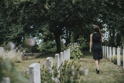 Young widow at the grave
