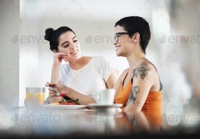 Same Sex Lgbt Partners Eating Breakfast Having Fun At Home