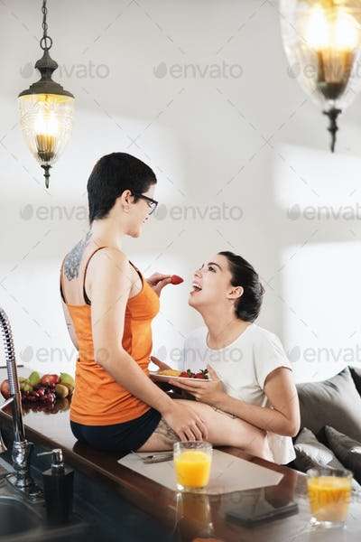 Love Affection Flirt For Lesbian Couple Eating Breakfast At Home
