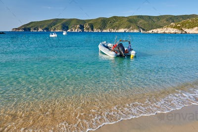 Rocky beach with boats landscape, Sithonia, Greece