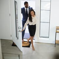 Businessman And Businesswoman Returning Home From Work