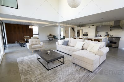 Seating Area And Kitchen In Stylish And Contemporary Empty Home