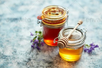 Jars with different kinds of fresh organic honey