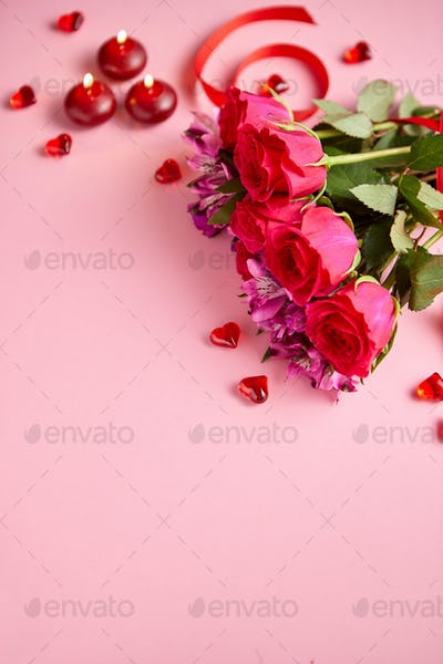 Mixed flowers bouquet with roses, candles and heart shaped acrylic decorations