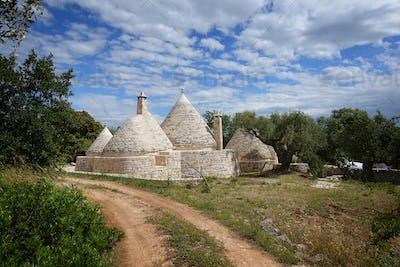 Trulli houses with driveway and garden
