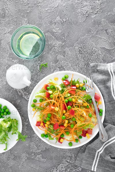 Fresh vegetable salad with raw carrot