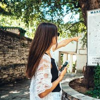 Woman points to the city's landmarks map