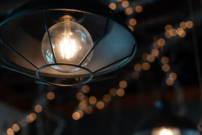 Lamp hanging outside on a dark background