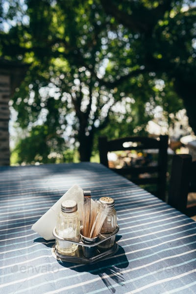 Close up white table setting in restaurant