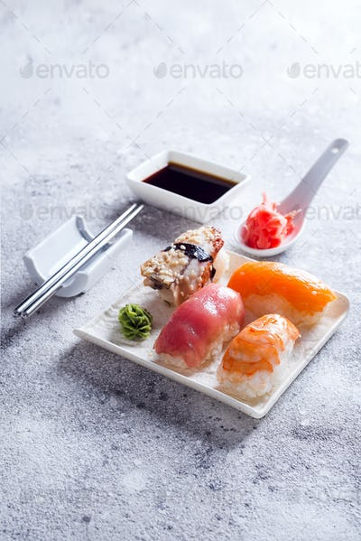Macro shot of sashimi, uramaki and nighiri, Japanese dish consisting of rice, salmon or tuna, shrimp
