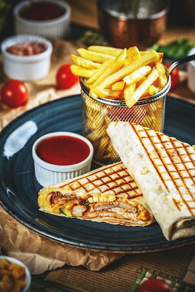 Tortilla wraps with grilled chicken fillet