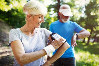 Senior sporty people living healthy lifestyle outdoor