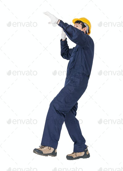 Workman with blue coveralls and hardhat in a uniform with clipping path