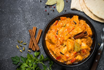 Chicken tikka masala on black top view