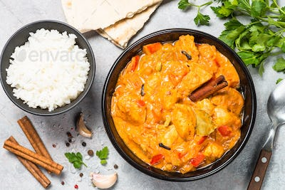 Chicken tikka masala with rice top view