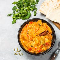 Chicken tikka masala with rice on black top view