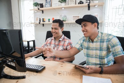 asian small office with two employee working