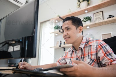 man working in home office seriously look at computer