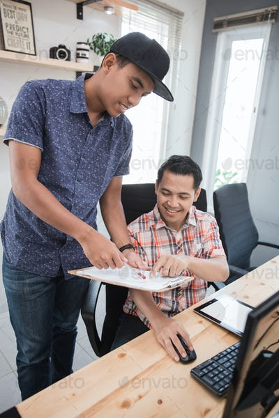 businessman with trainee in casual shirt discussing
