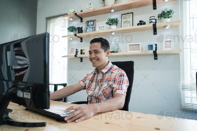 small company owner working in his compact office