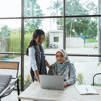 a women boss accompanies employees to job supervision